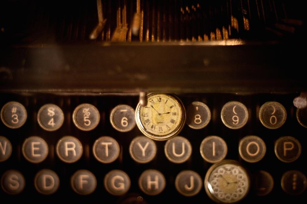 typewriter and clocks